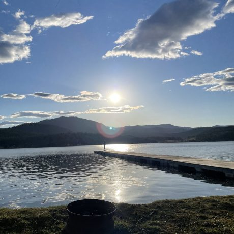 Lake man fishing in the distance image